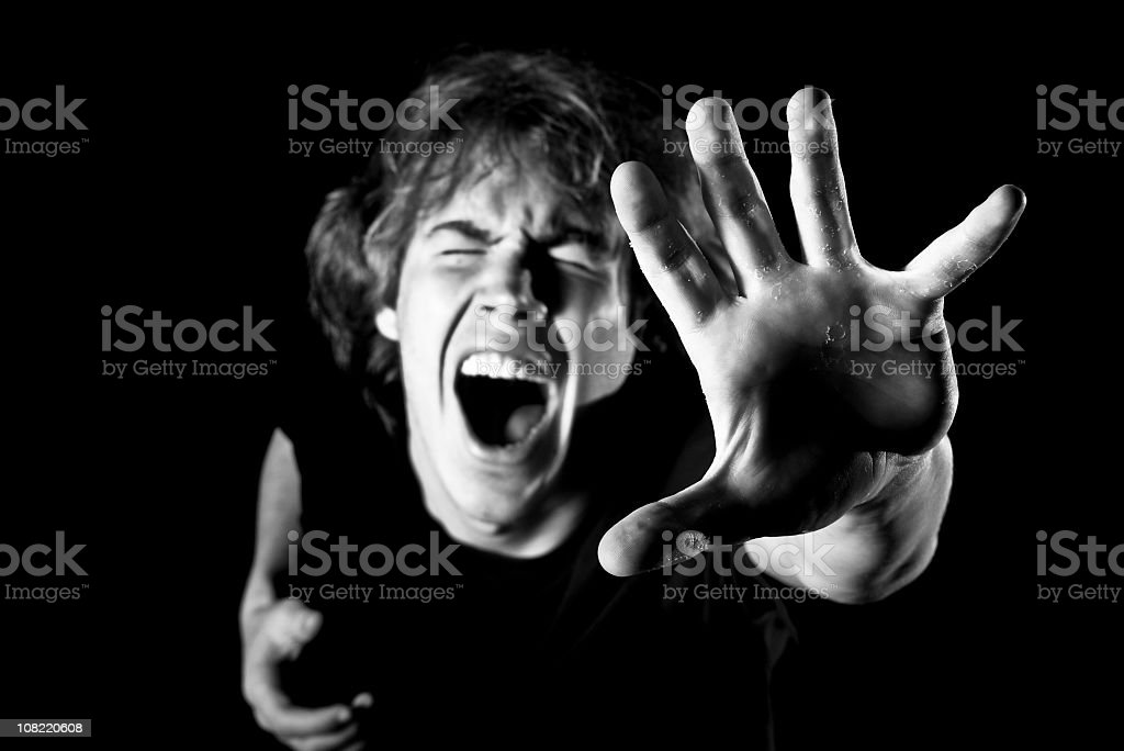 Portrait of Young Man Yelling Reaching Up, Black and White royalty-free stock photo