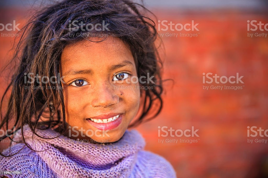 Portrait of young Nepali girl in Bhaktapur, Nepal stock photo