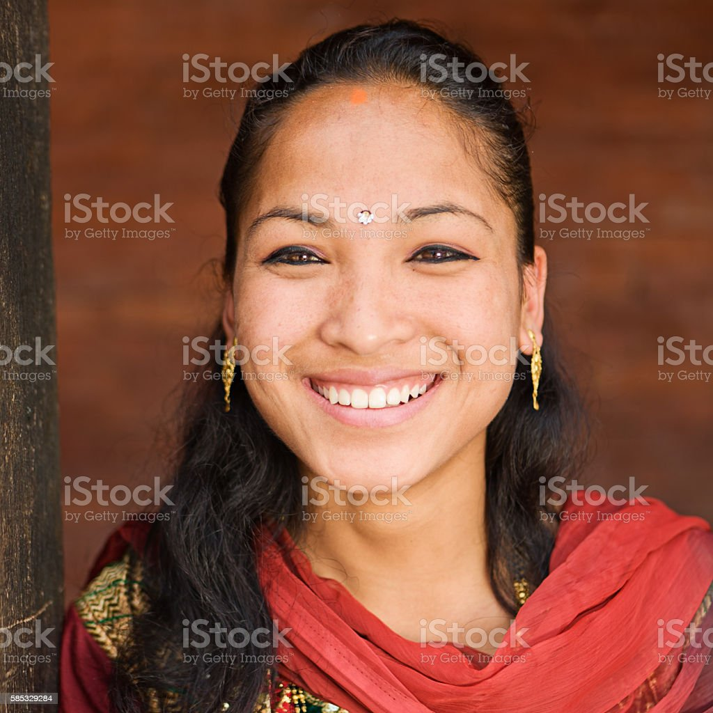 Portrait of young Nepali girl wearing traditional costume, Bhaktapur. stock photo