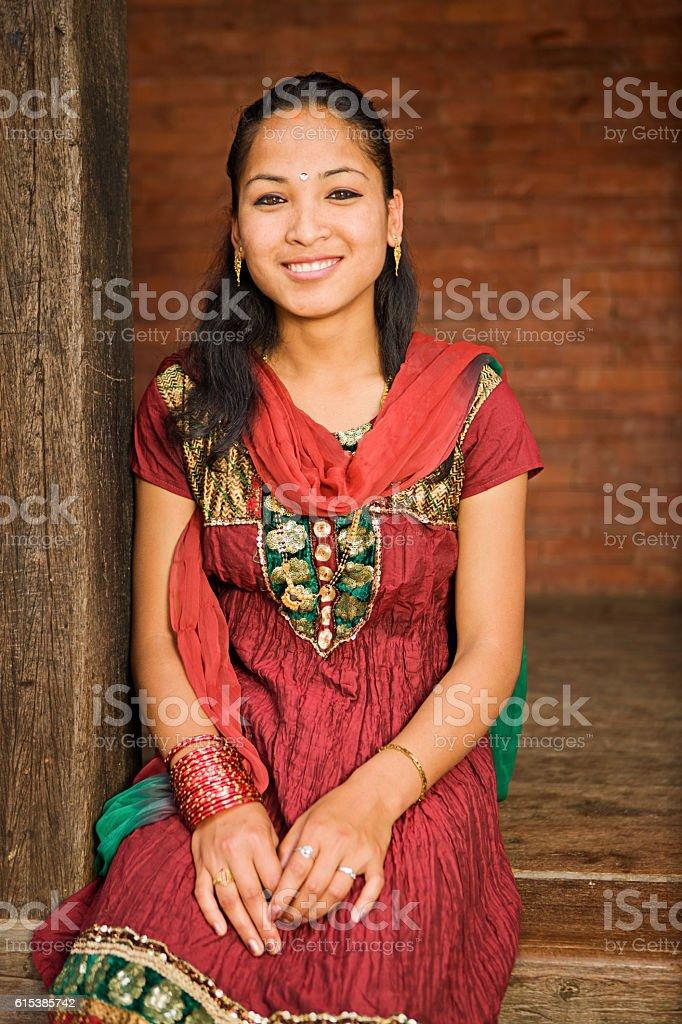 Portrait of young Nepali girl wearing traditional costume, Bhaktapur. stock photo