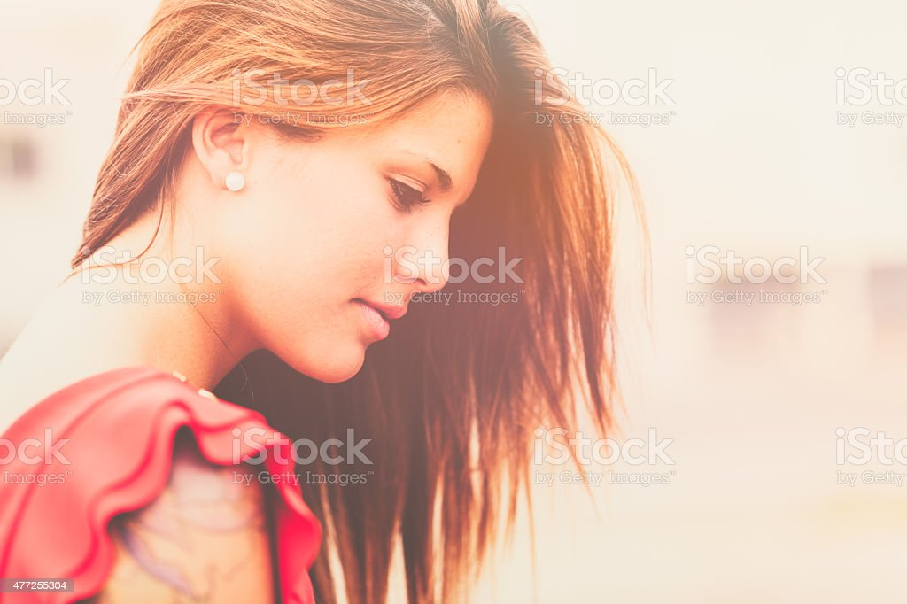 Portrait of young pensive woman stock photo