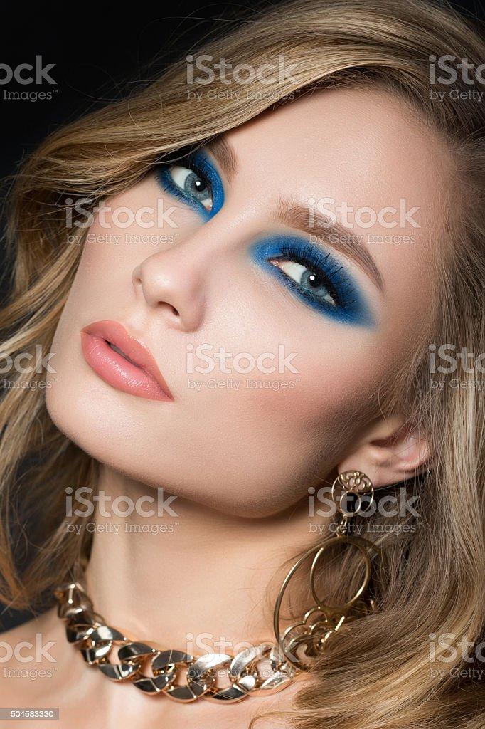 Portrait of young pretty blonde woman with fashion makeup stock photo