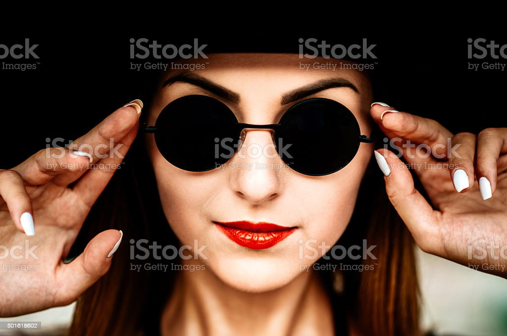 Portrait of young pretty women in black hat stock photo