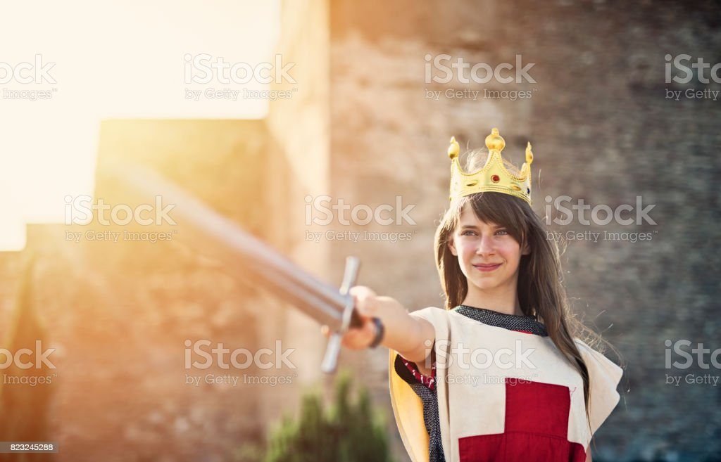 Portrait of young queen at the castle walls stock photo