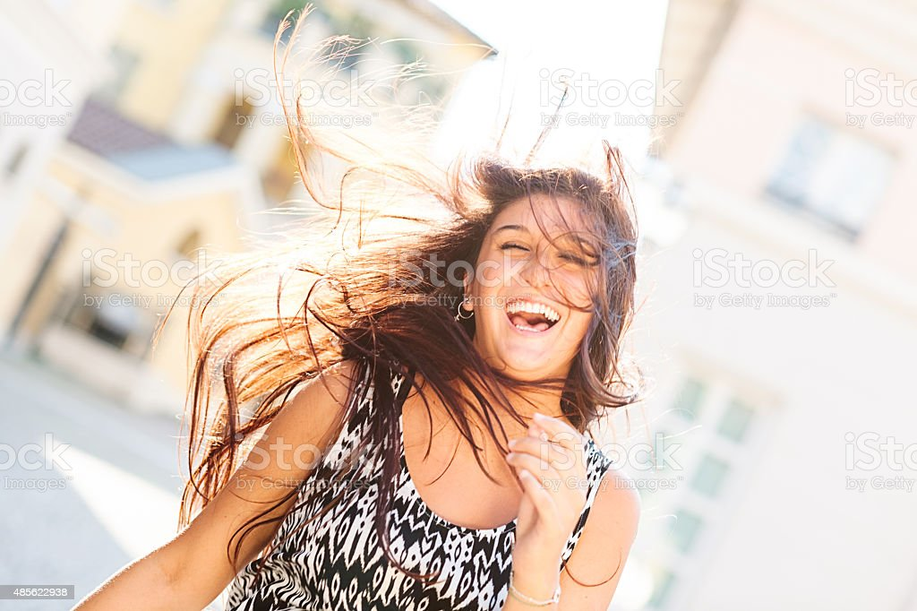 Portrait of young real woman on the move stock photo