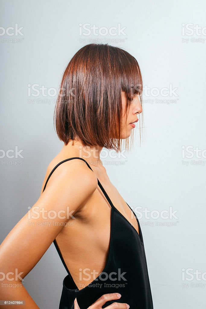 Portrait of young red head woman with modern hairstyle stock photo
