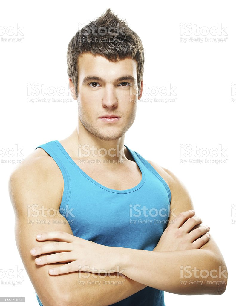 portrait of young serious man against white background royalty-free stock photo