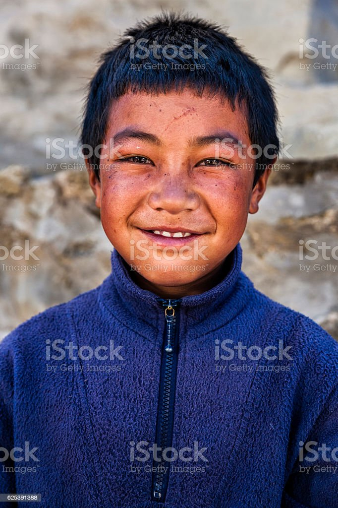 Portrait of young Sherpa boy in Everest Region stock photo