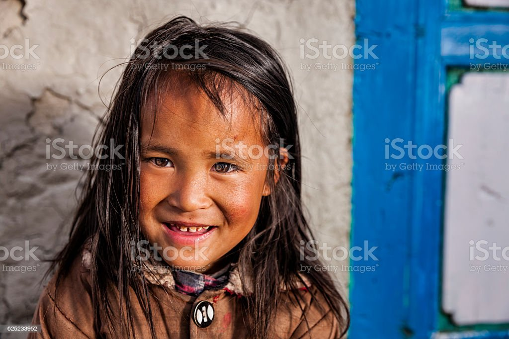 Portrait of young Sherpa girl in Everest Region stock photo