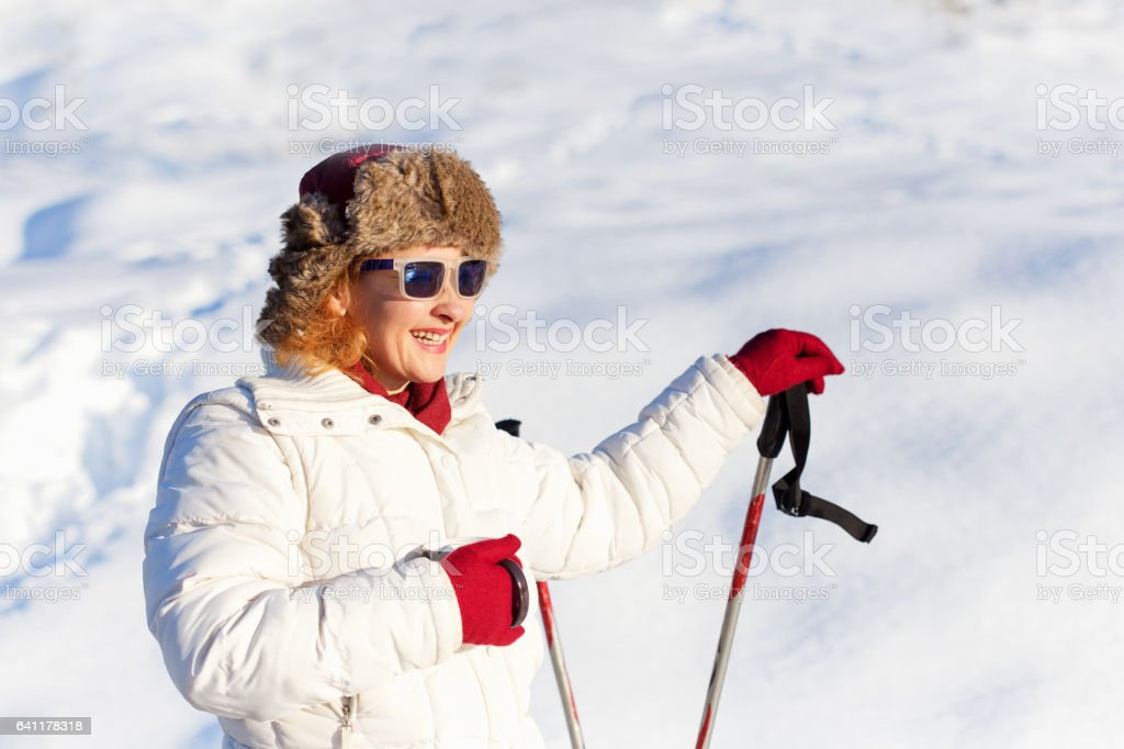 Portrait of young skier holding skis stock photo