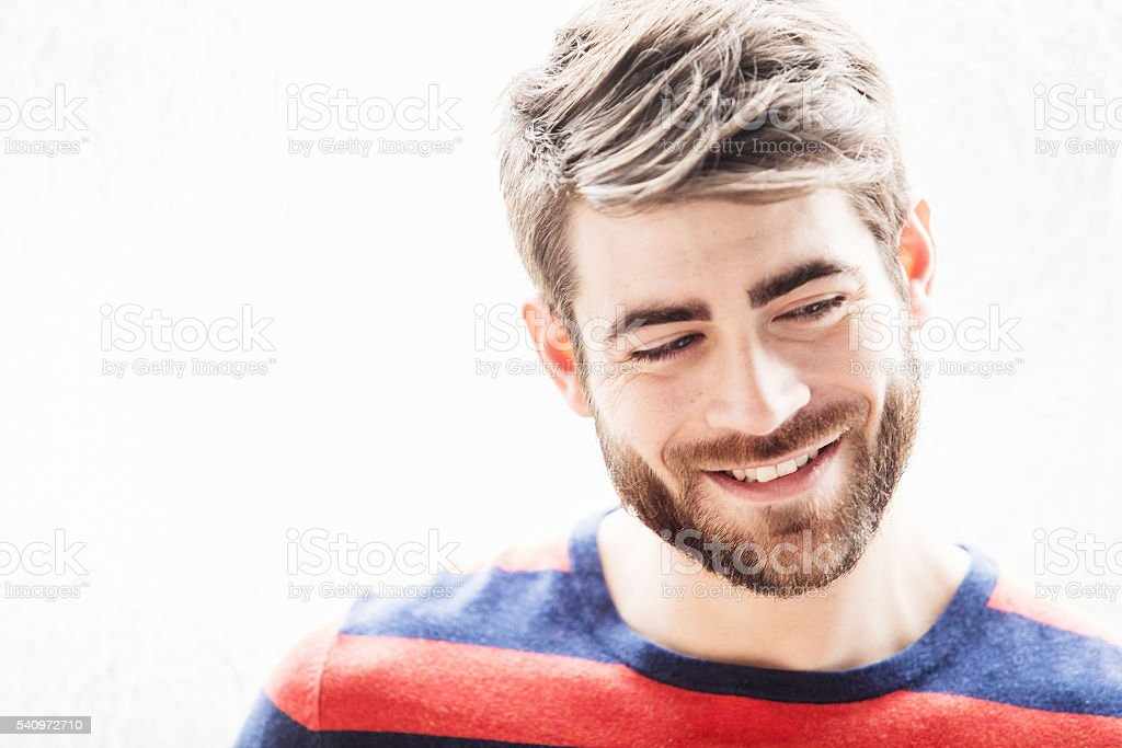 Portrait of young smart french guy at window stock photo
