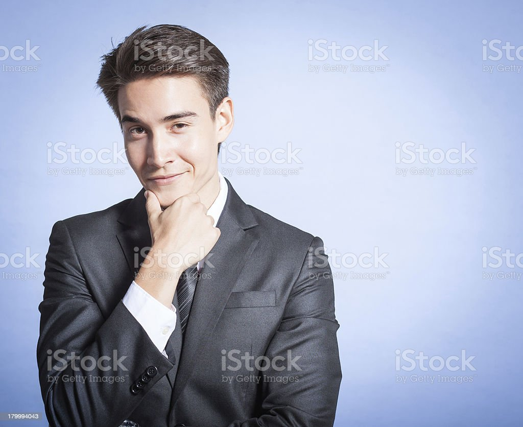Portrait of young smiling businessman royalty-free stock photo