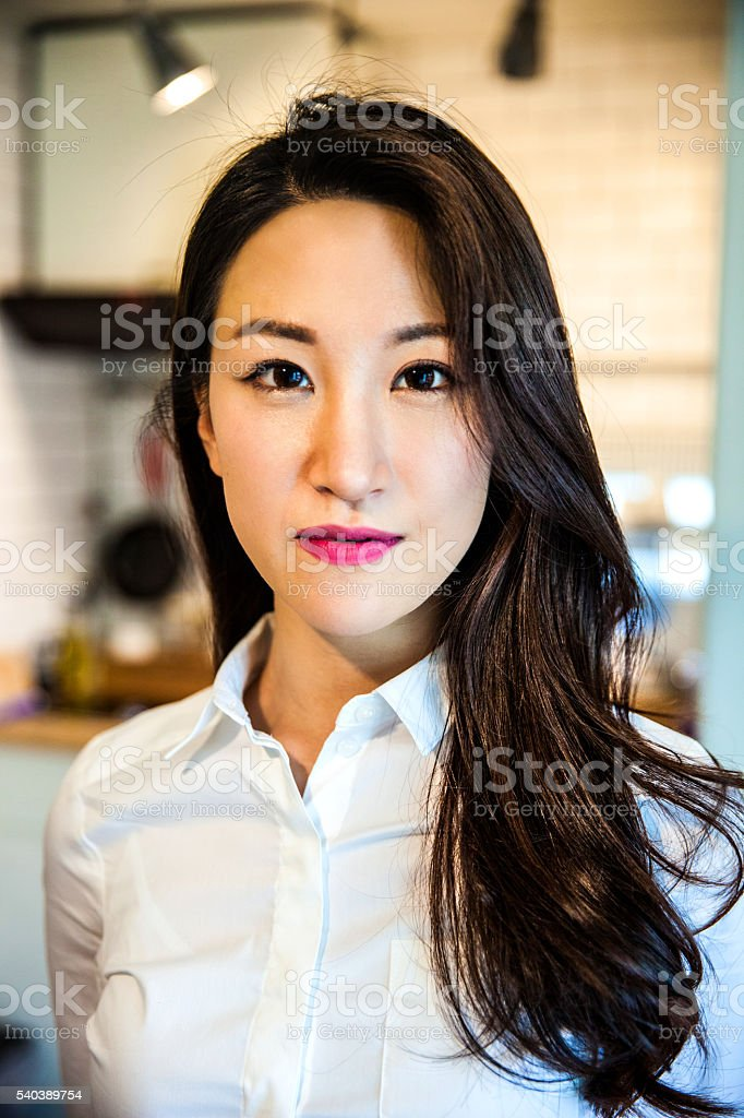 Portrait of young successful woman at home in Seoul stock photo