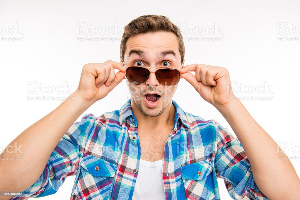 portrait of young surprised man in glasses stock photo