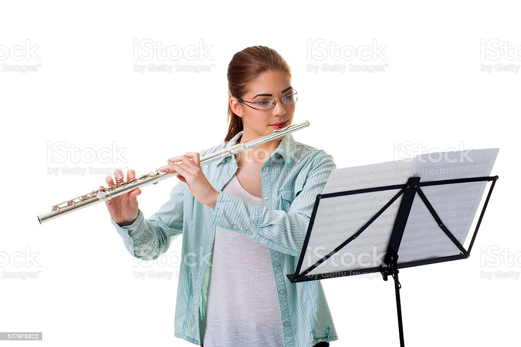 Portrait of  young teenage girl playing flute. stock photo