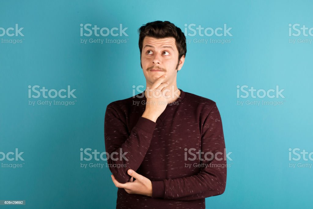 Portrait of young thoughtful man. stock photo