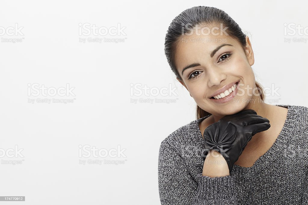 Portrait of young woman against grey background royalty-free stock photo
