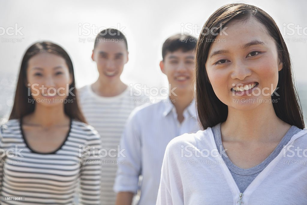 Portrait of Young Woman and Friends at the Beach royalty-free stock photo