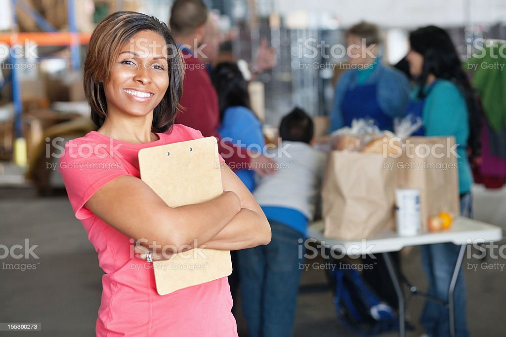Portrait of young woman at donation facility royalty-free stock photo