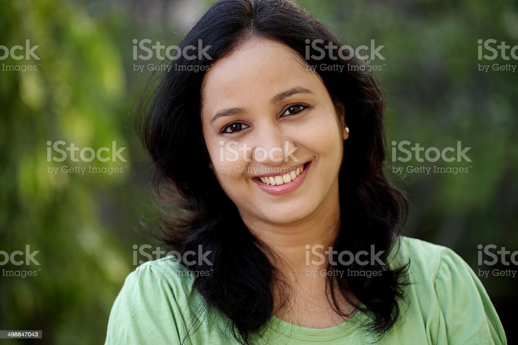 Portrait of young woman at outdoors stock photo