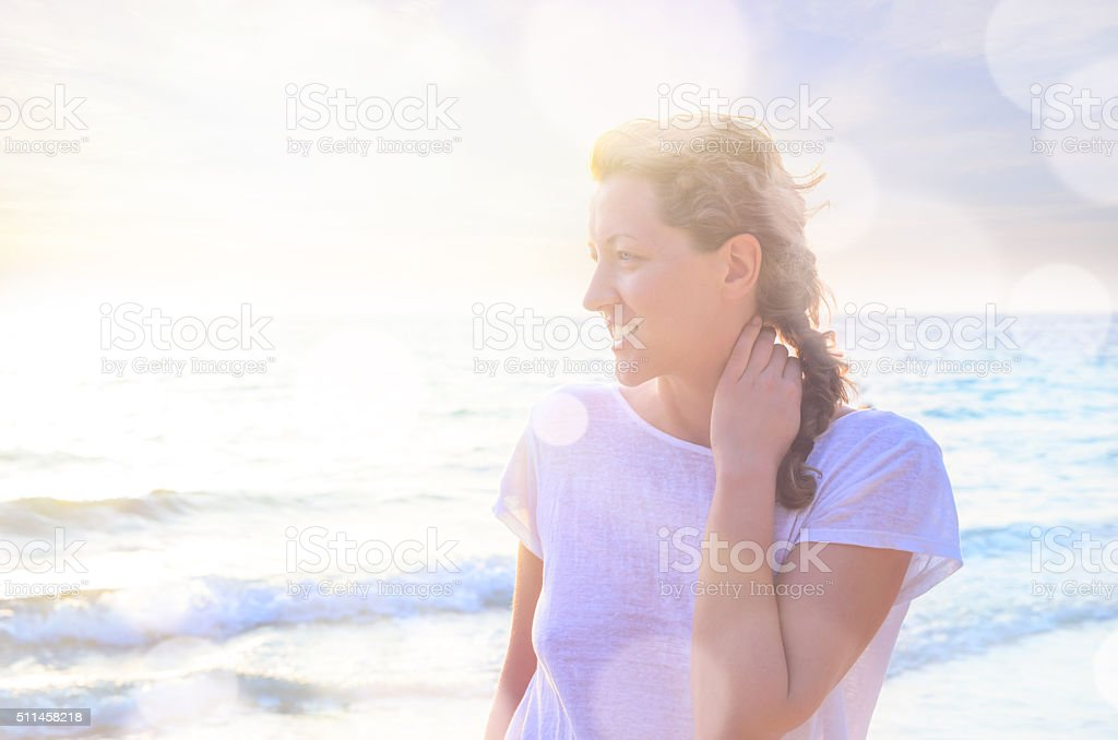 Portrait of young woman at the beach stock photo