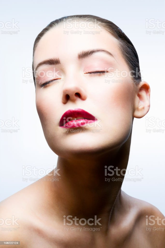 Portrait of Young Woman Closing Eyes royalty-free stock photo
