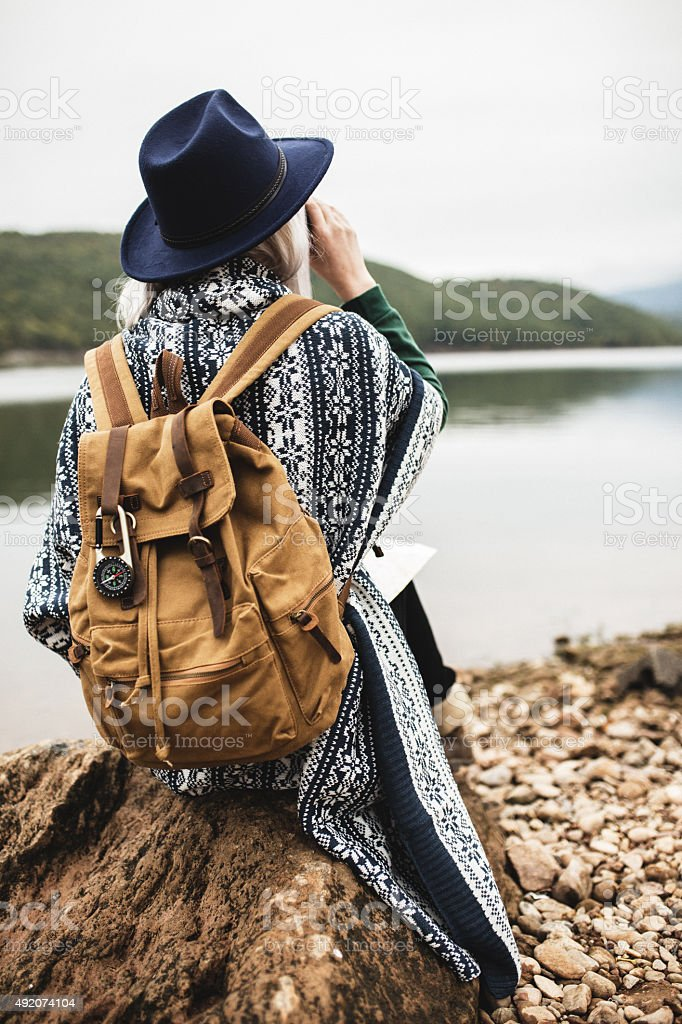 Portrait of young woman dressed in poncho and hat stock photo