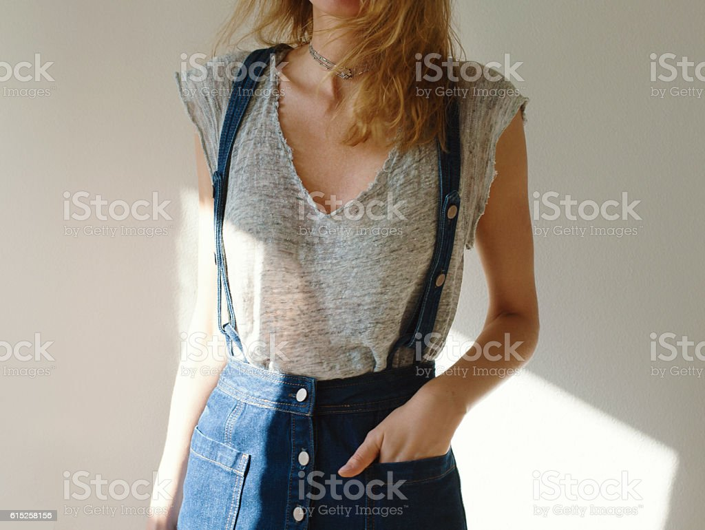 Portrait of young woman dressed skirt and t-shirt. stock photo