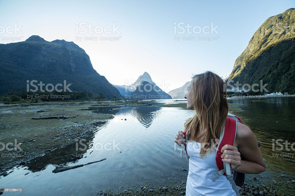Portrait of young woman hiking in Milford sound, New Zealand stock photo
