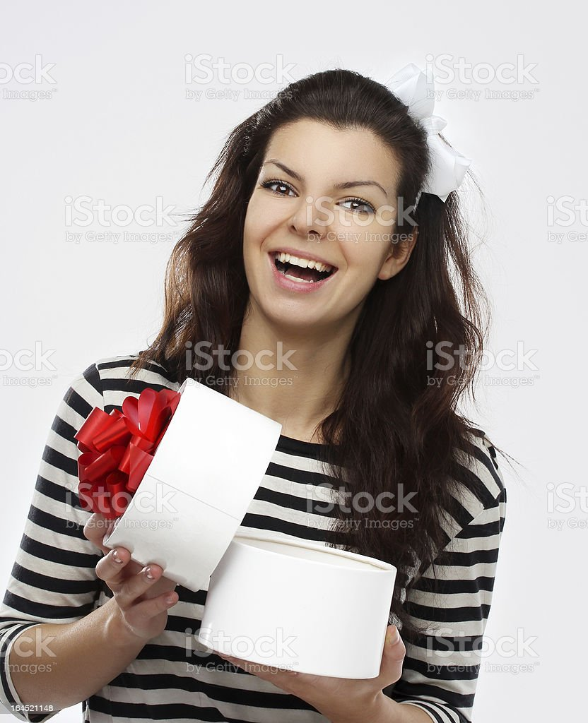 Portrait of young  woman  holding a white gift box royalty-free stock photo