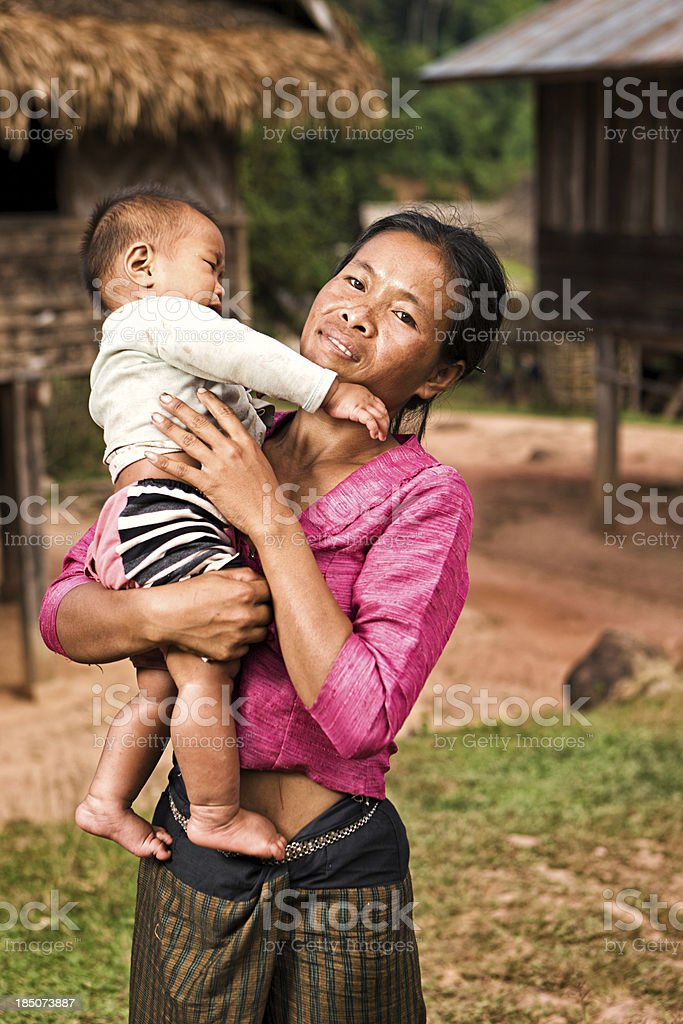 Portrait of young woman holding her baby in Northern Laos royalty-free stock photo