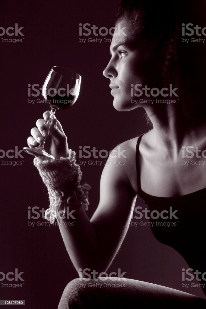 Portrait of Young Woman Holding Wine Glass, Toned royalty-free stock photo