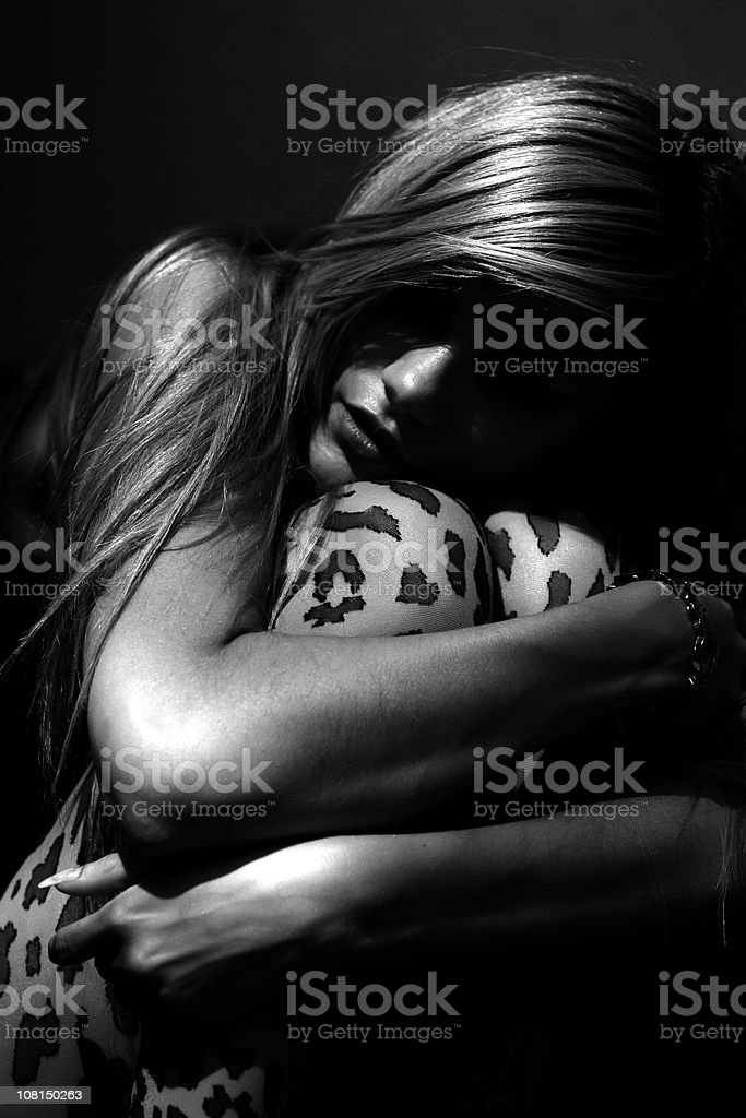 Portrait of Young Woman Hugging Her Knees, Black and White royalty-free stock photo