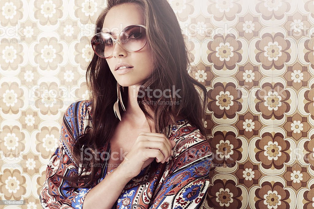 Portrait of young woman in 1970's fashion stock photo