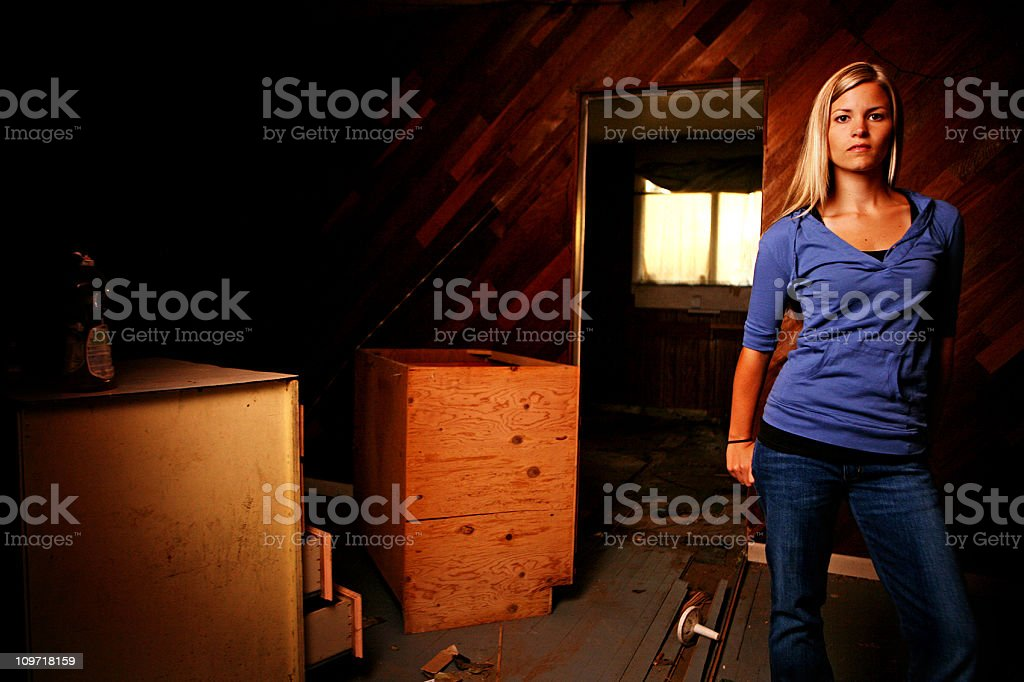 Portrait of Young Woman in Abandoned House stock photo