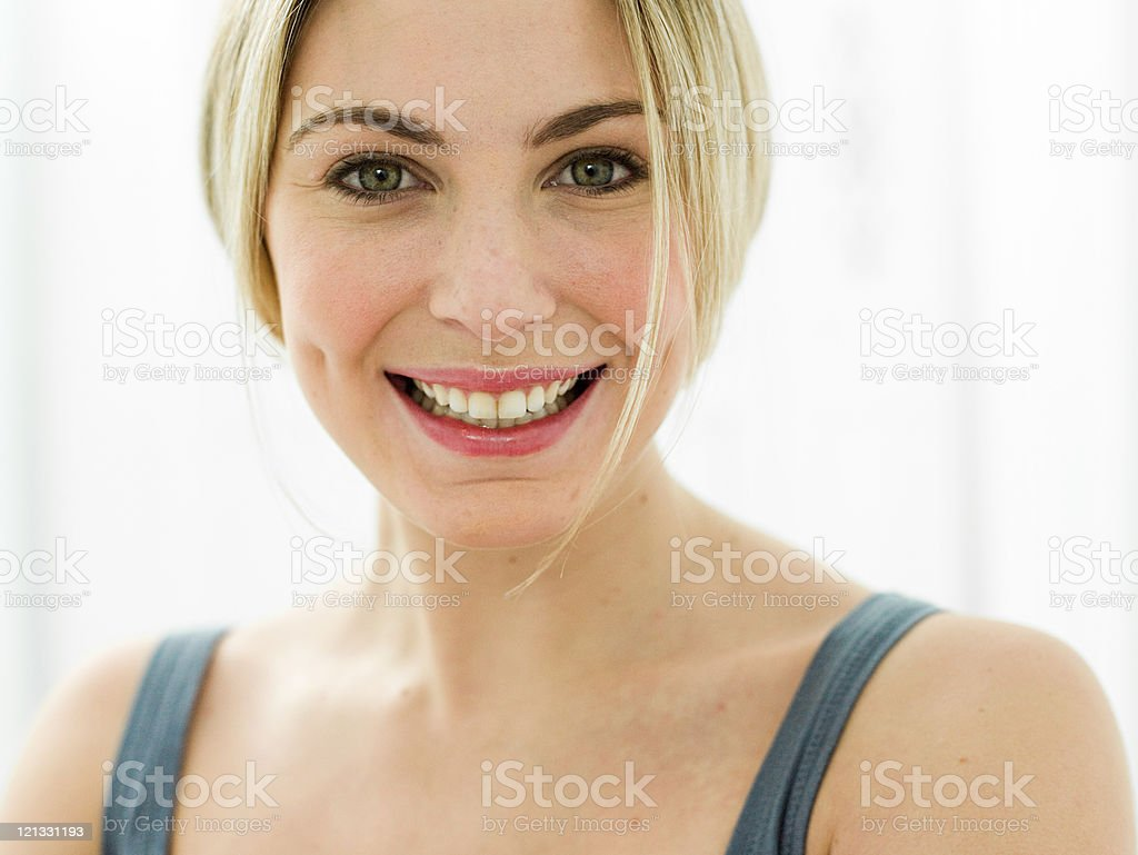 Portrait of young woman in bathroom stock photo