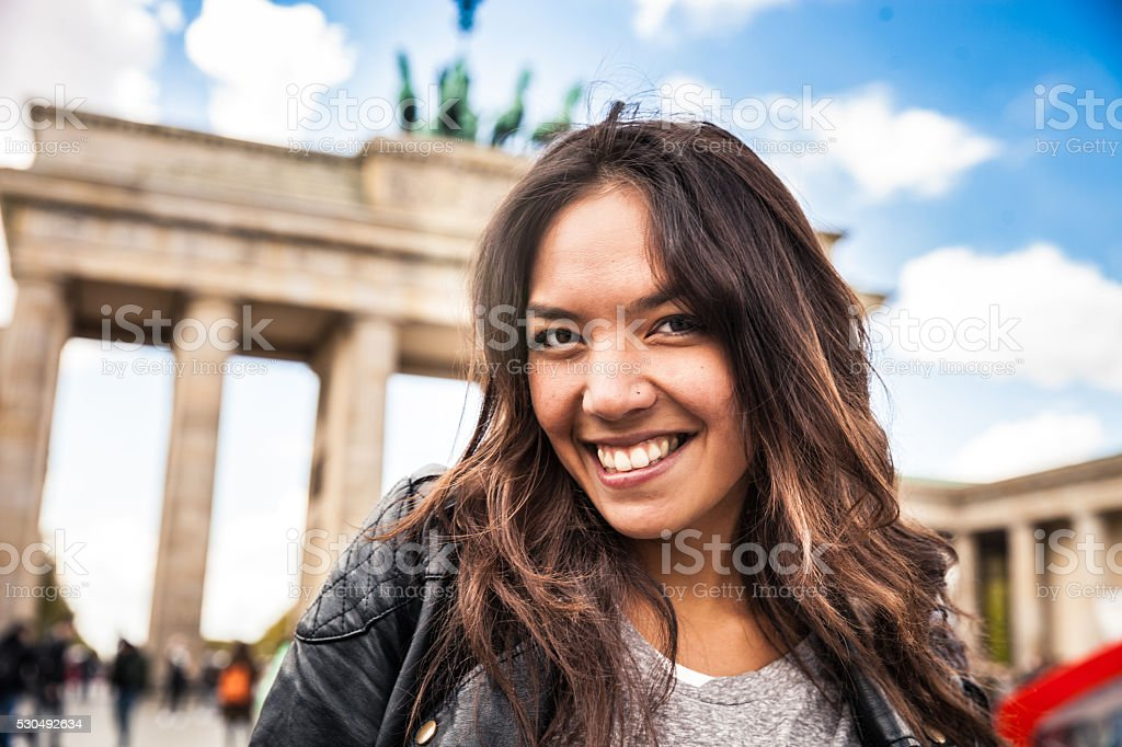 Portrait of young woman in Berlin - Brandenburg Gate stock photo