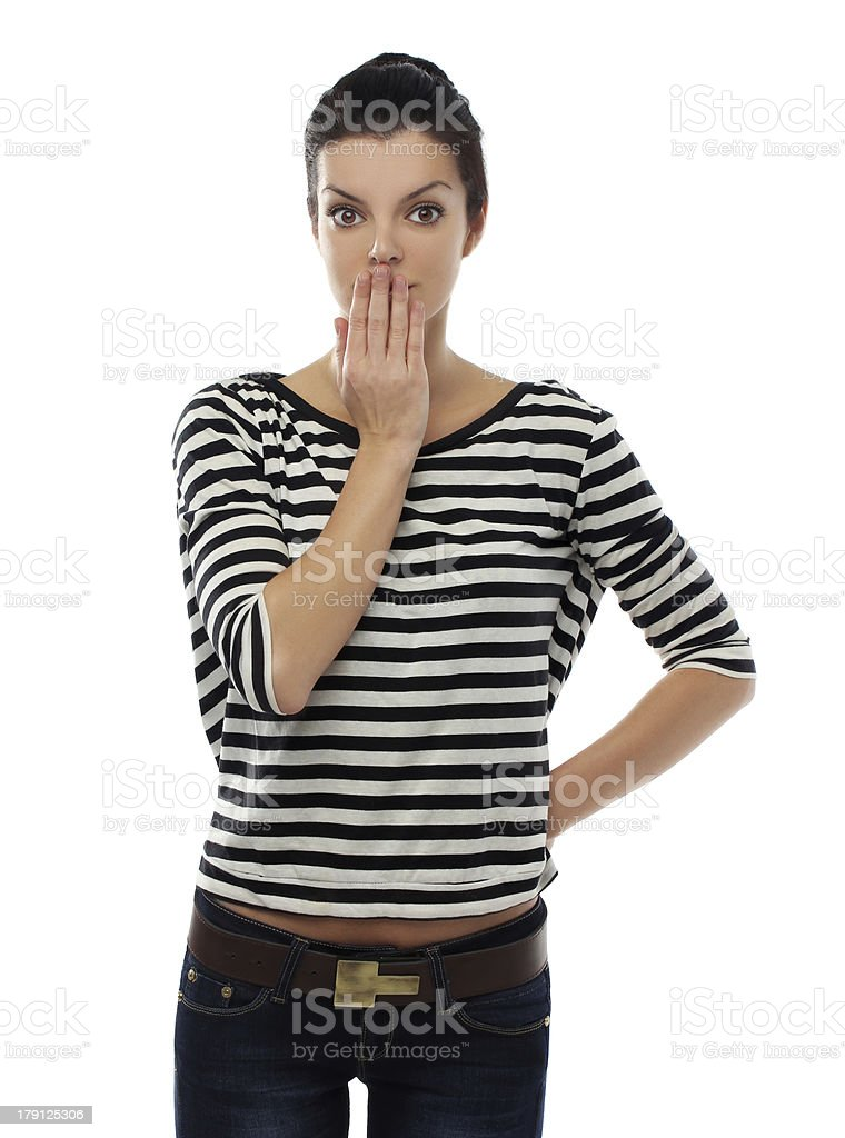 Portrait of young woman in confusion with hands covering mouth royalty-free stock photo