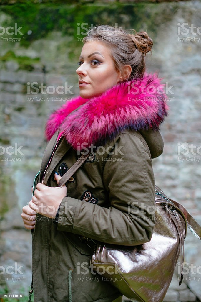 Portrait of young woman in jacket with purple fur stock photo