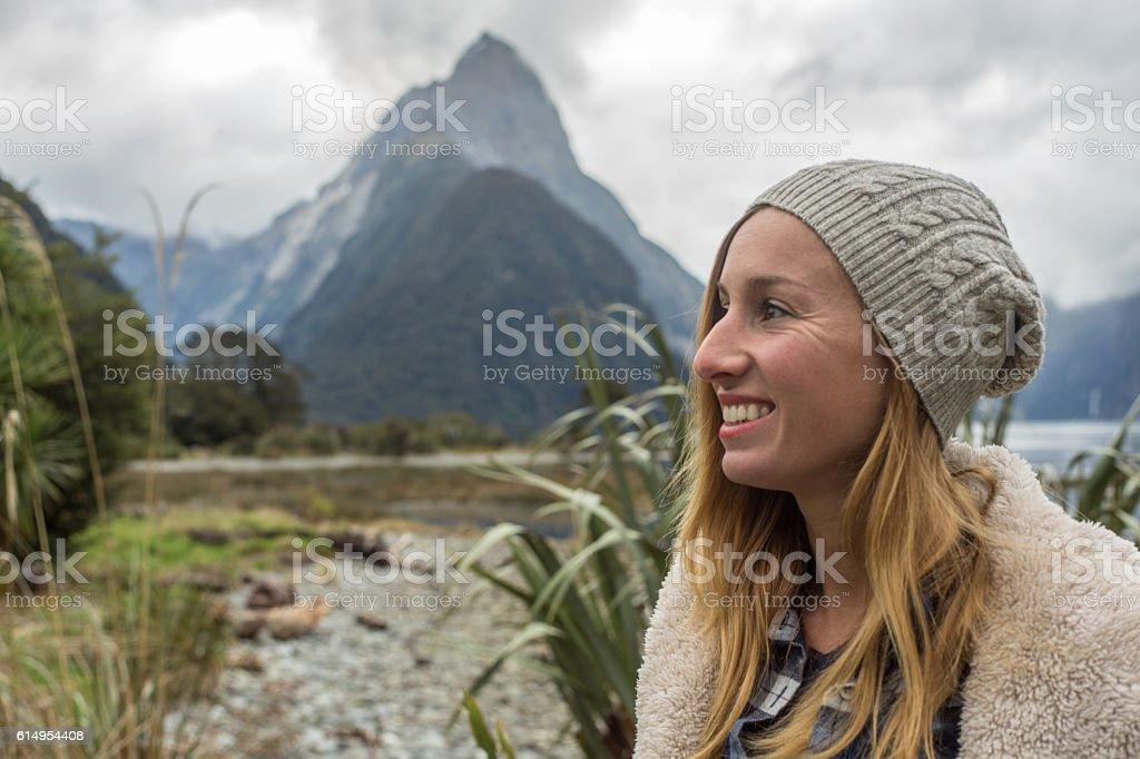 Portrait of young woman in Milford Sound, New Zealand stock photo