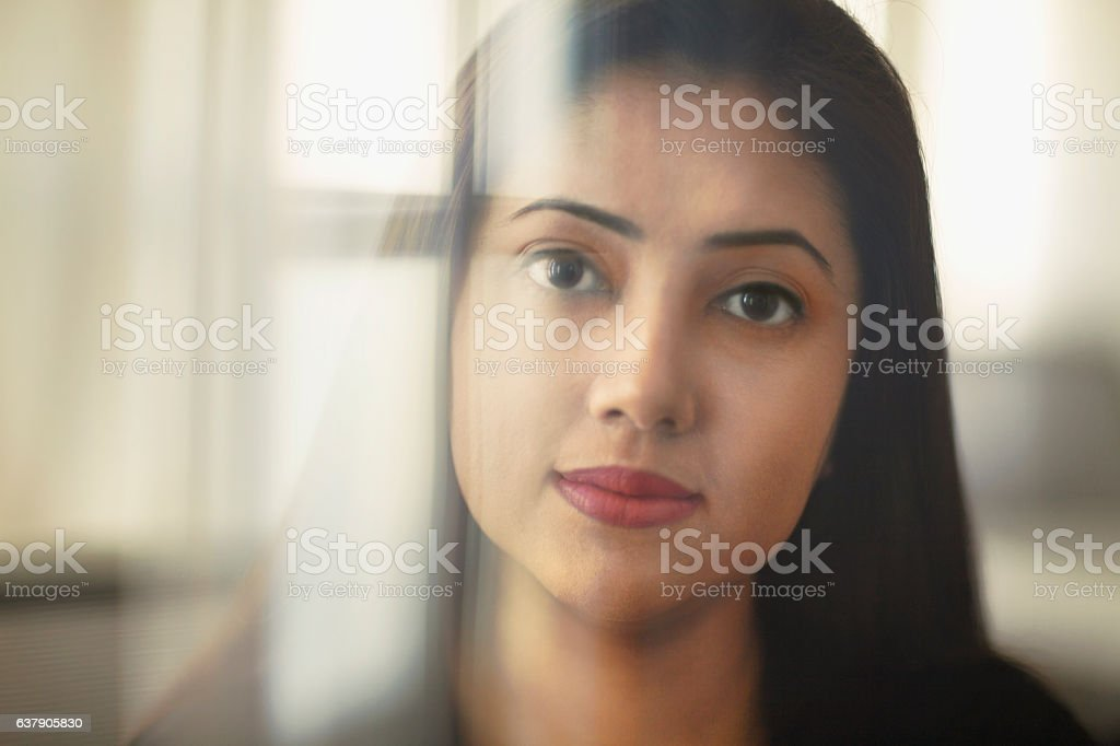 Portrait of young woman in office stock photo