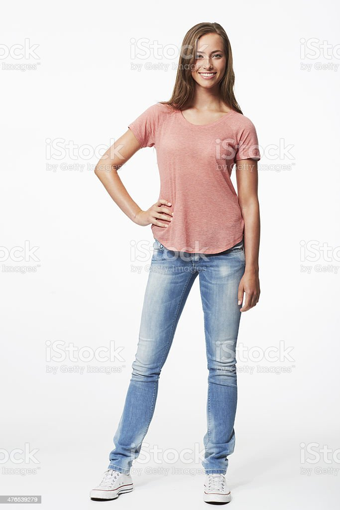 Portrait of young woman in studio, smiling stock photo