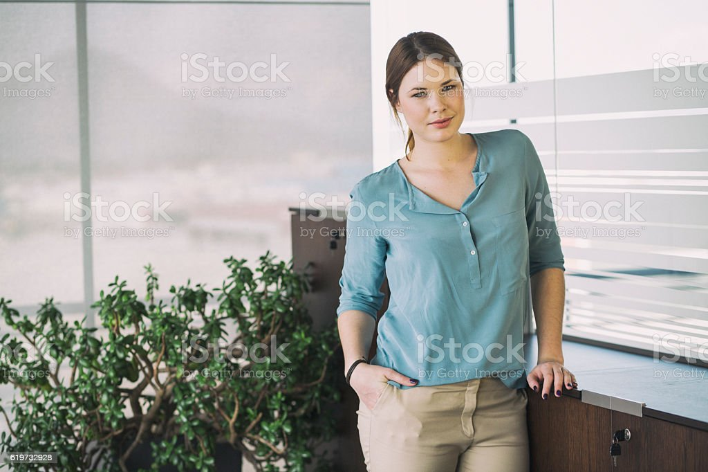 Portrait of young woman in the office stock photo