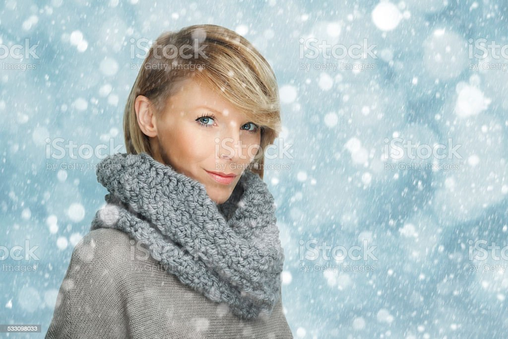 Portrait of young woman in the snow stock photo