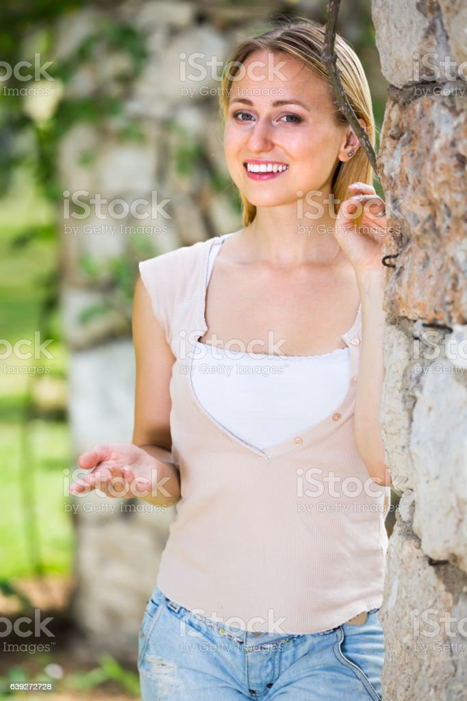 portrait of young woman in the yard stock photo