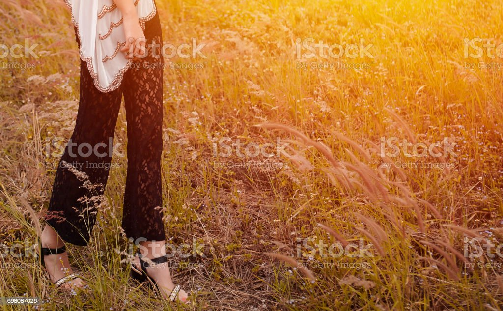 Portrait of young woman in wheat field stock photo