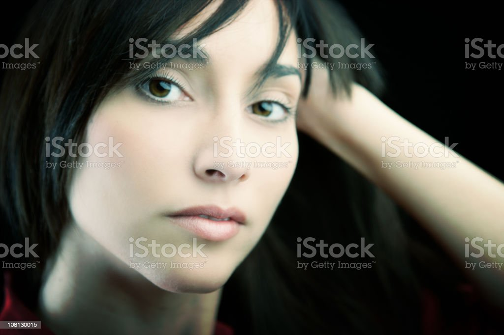 Portrait of Young Woman Leaning Head on Hand stock photo