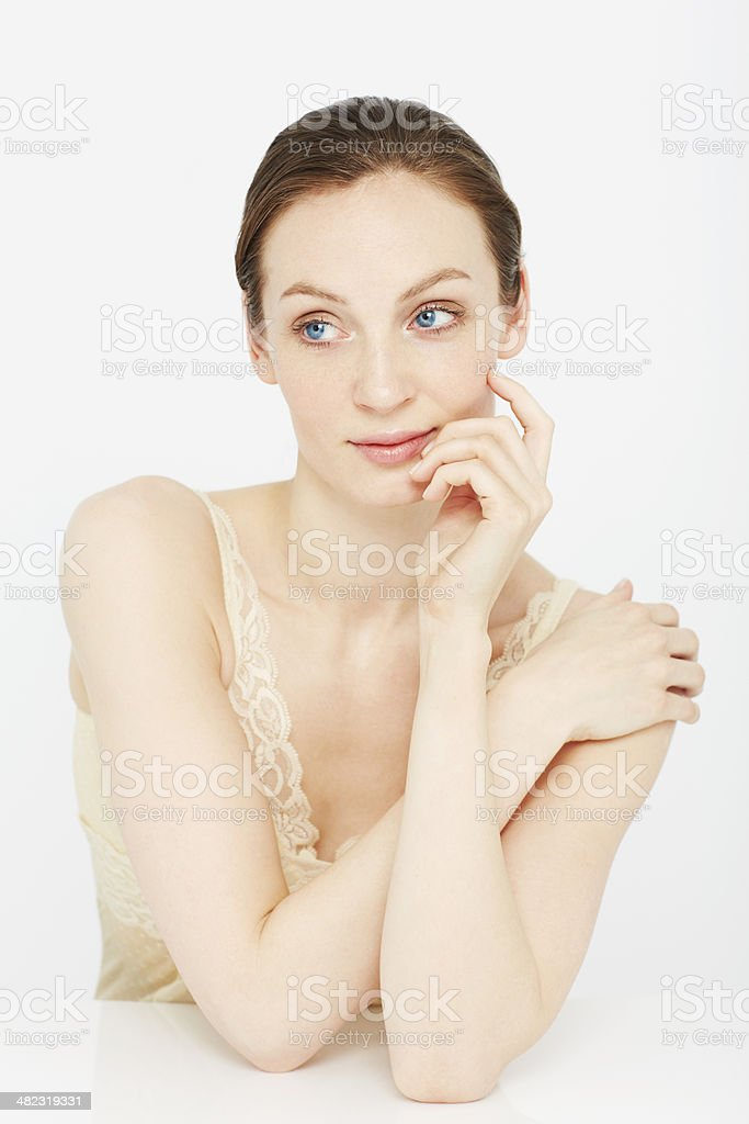 Portrait of young woman looking away in lace camisole stock photo