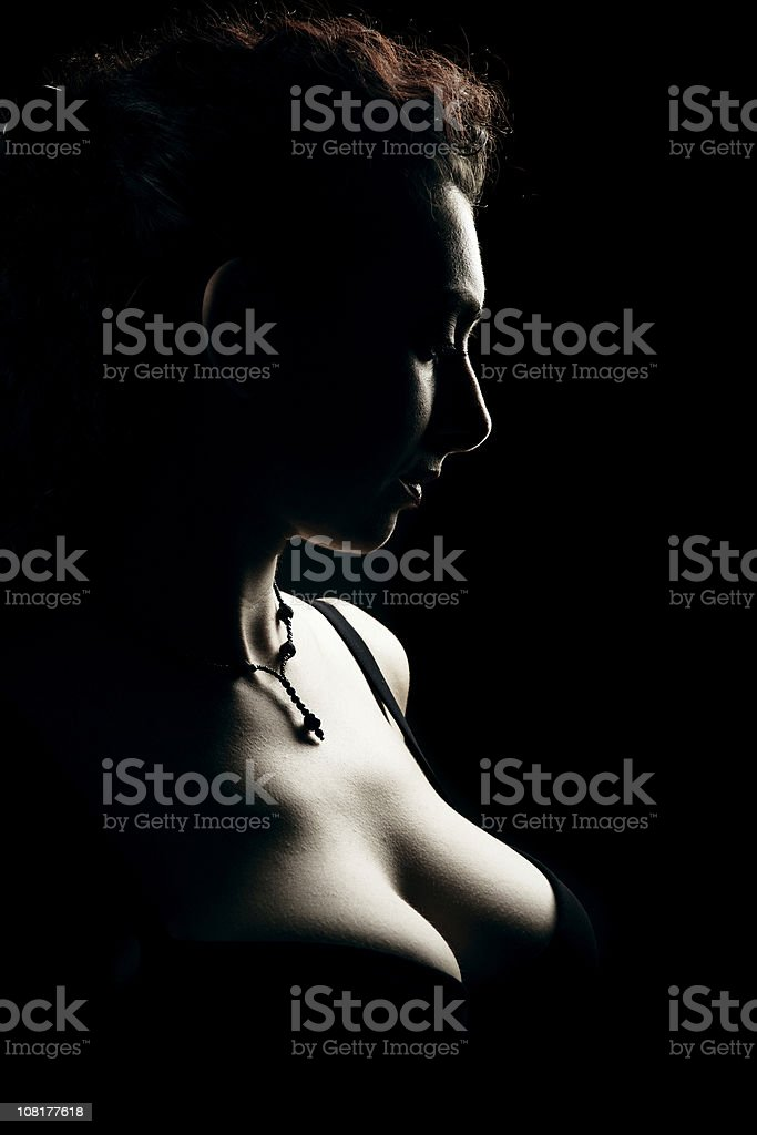 Portrait of Young Woman, Low Key on Black Background royalty-free stock photo