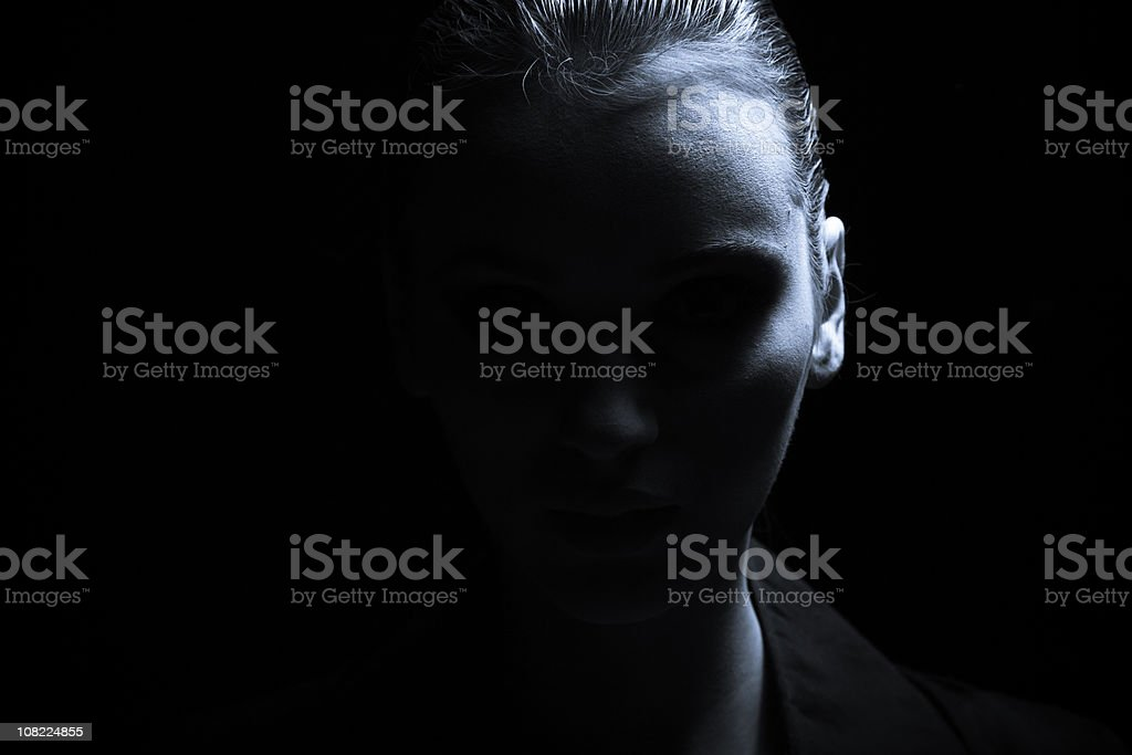 Portrait of Young Woman, Low key stock photo